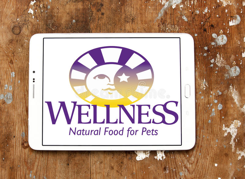 Wellness pet food logo. Logo of wellness pet food company on samsung tablet on wooden background stock image