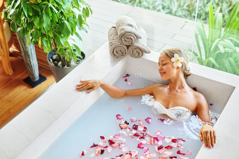 Wellness. Skin, Body Care Spa Therapy. Woman In Bath. Beauty. Wellness. Skin, Body Care Spa Therapy. Closeup Beautiful Blonde Young Woman In Bikini Relaxing In royalty free stock images