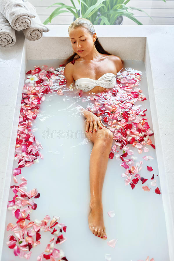 Wellness. Skin, Body Care Spa Therapy. Woman In Bath. Beauty. Wellness. Skin, Body Care Spa Therapy. Closeup Beautiful Blonde Young Woman In Bikini Relaxing In royalty free stock photography