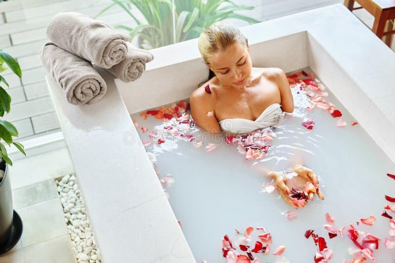 Wellness. Skin, Body Care Spa Therapy. Woman In Bath. Beauty. Wellness. Skin, Body Care Spa Therapy. Closeup Beautiful Blonde Young Woman In Bikini Relaxing In stock photos
