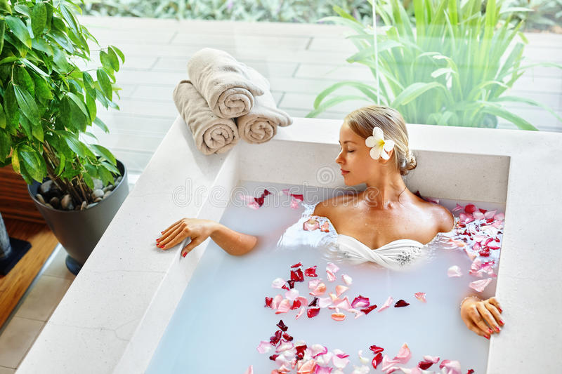 Wellness. Skin, Body Care Spa Therapy. Woman In Bath. Wellness. Skin, Body Care Spa Therapy. Closeup Beautiful Blonde Young Woman In Bikini Relaxing In Flower royalty free stock photos