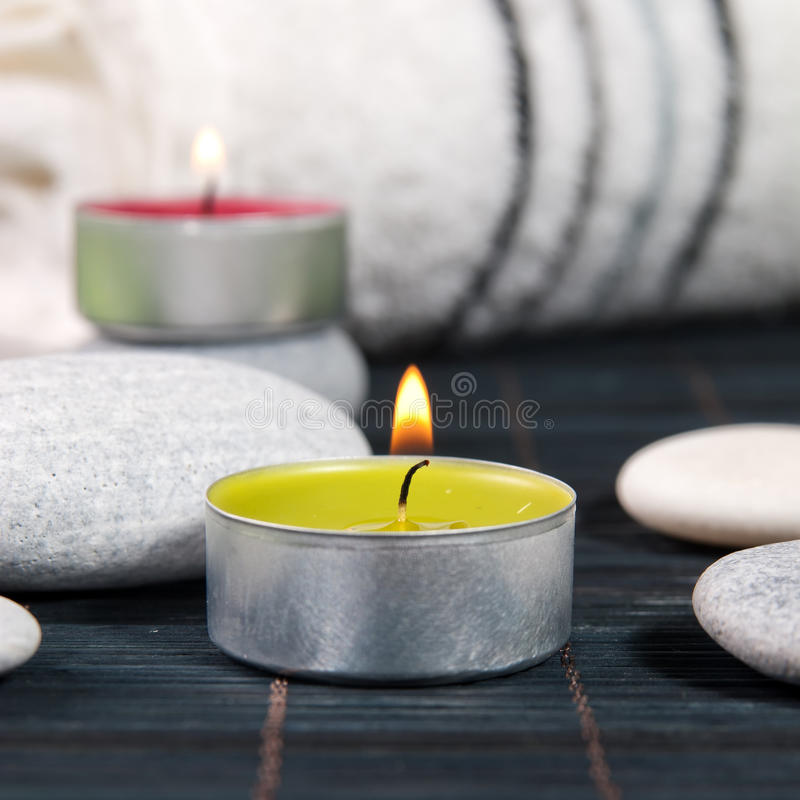 Wellness and spa concept with candles royalty free stock photo