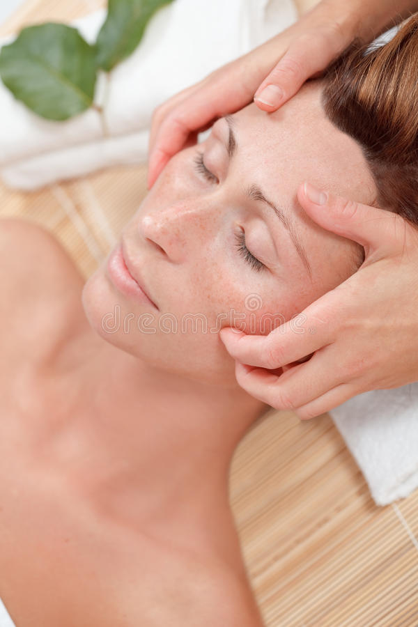 Wellness woman. Relaxing woman enjoying wellbeing wellness spa therapy stock image