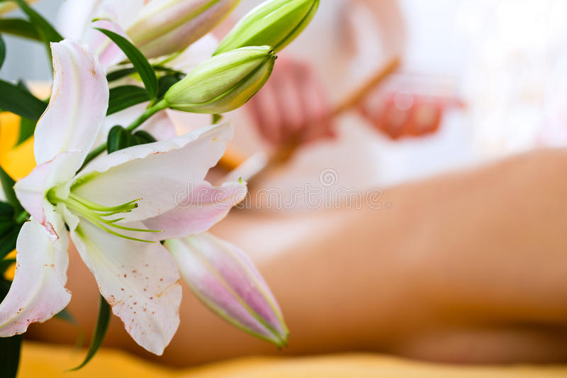 Wellness - woman getting body massage in Spa. Wellness - woman receiving body or back massage in spa royalty free stock image