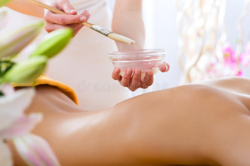 Wellness - woman getting body massage in Spa royalty free stock photos