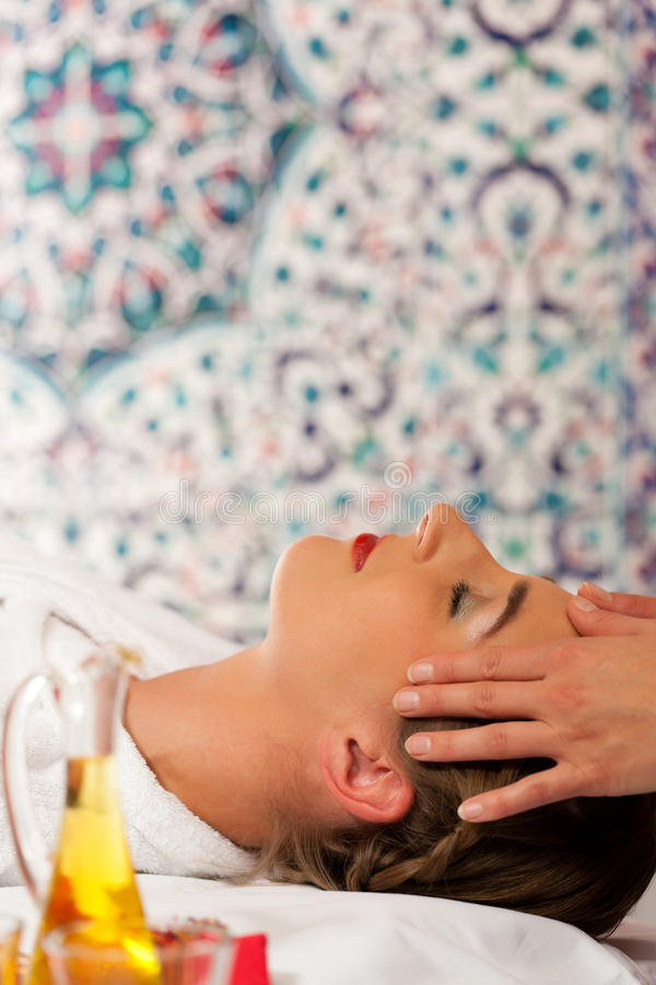 Wellness - woman getting head massage in Spa. Wellness - woman getting massage in Spa; it is a massage for the head royalty free stock image