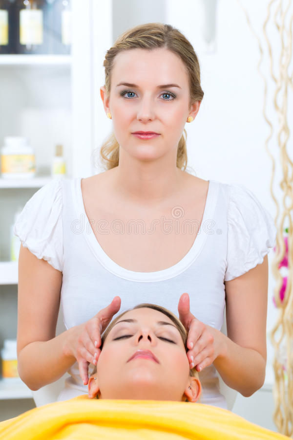 Wellness - woman getting head massage in Spa. Wellness - woman receiving head or face massage in spa royalty free stock image