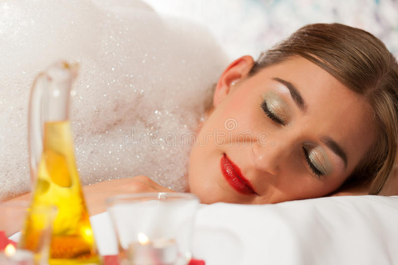 Wellness - woman getting massage in Spa. It is a massage with foam royalty free stock photos