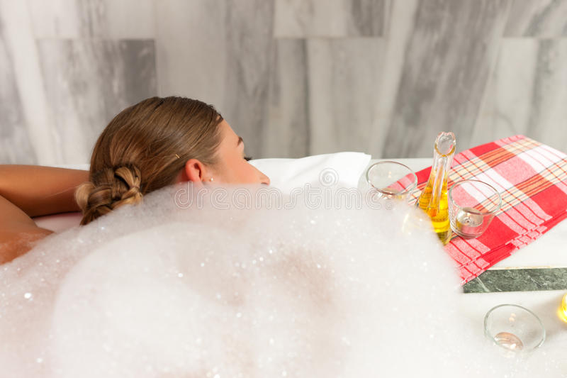 Wellness - woman getting massage in Spa. It is a massage with foam royalty free stock images