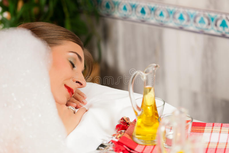Wellness - woman getting massage in Spa. It is a massage with foam stock images