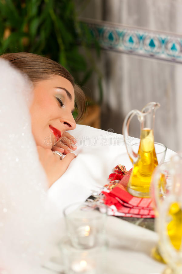 Wellness - woman getting massage in Spa. It is a massage with foam royalty free stock image