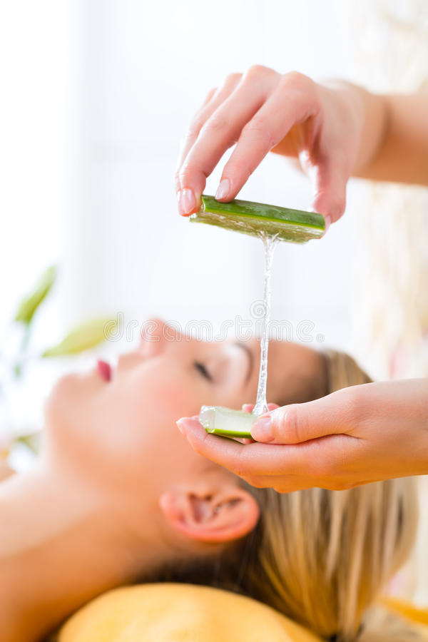 Wellness - woman having aloe vera application stock photography