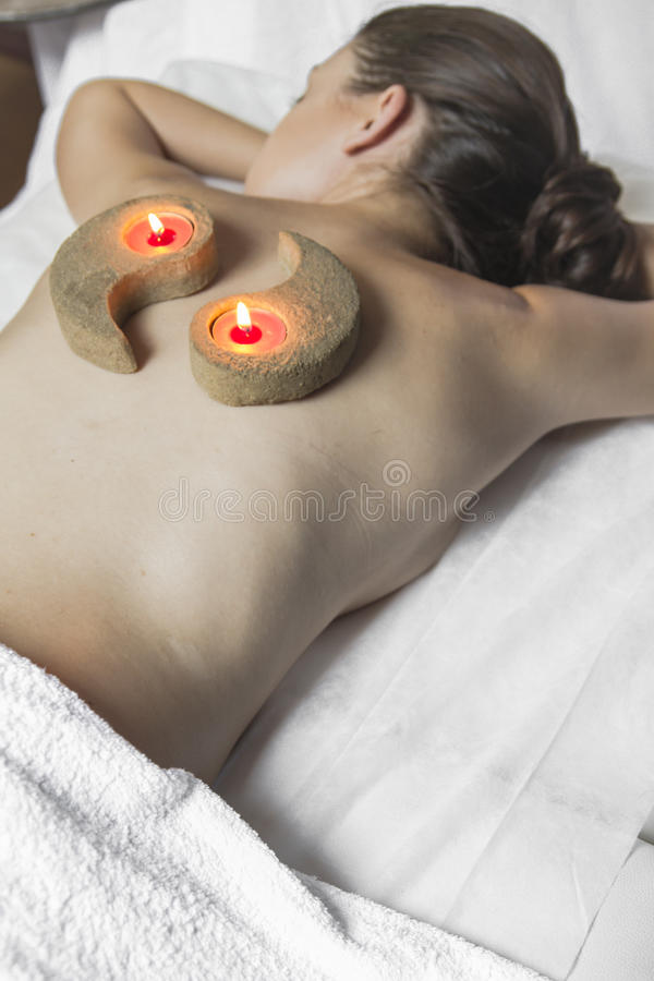 Wellness - woman receiving body or back massage in spa. Lady.portrait of young beautiful woman in spa environment, wellness stock image
