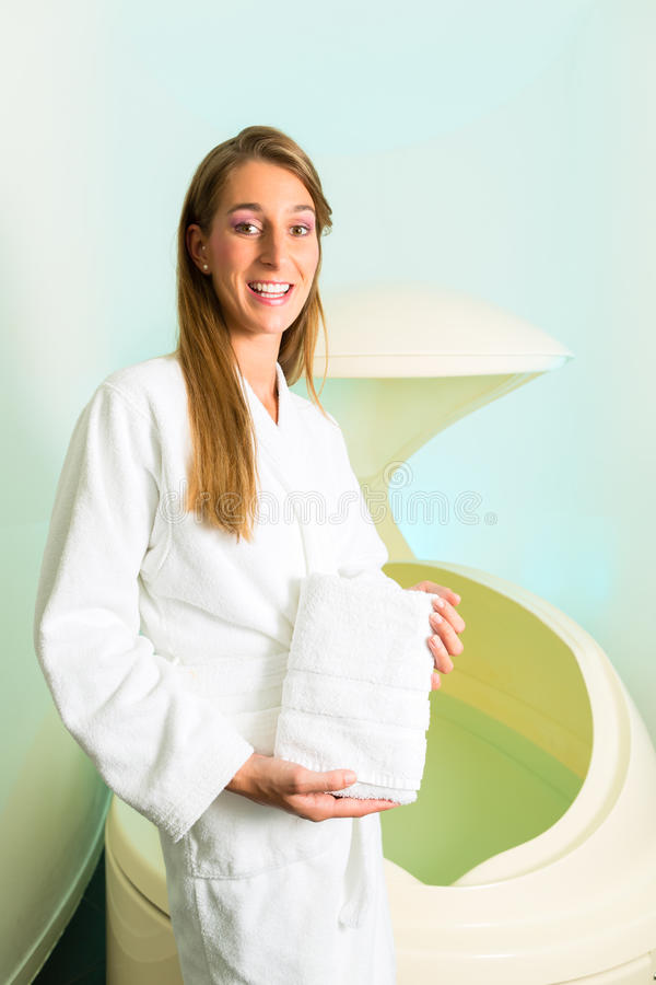 Wellness - Young Woman Floating In Spa In Tank Royalty Free Stock Photography