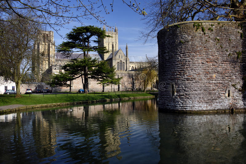 Wells Cathedral & Bishops Palace - Wells - England. Wells Cathedral viewed from over the moat of the medieval ramparts and moat of the Bishops Palace - City of royalty free stock photo