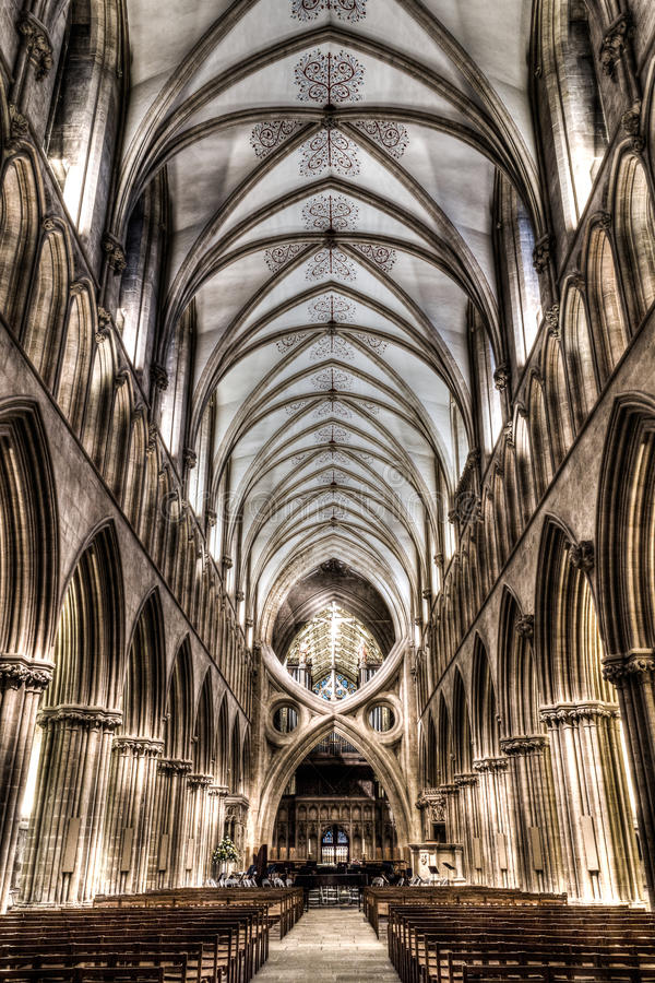 Wells Cathedral inside, Nave HDR. ENGLAND, WELLS - 13 FEB 2015: Wells Cathedral inside, Nave HDR photography stock photography