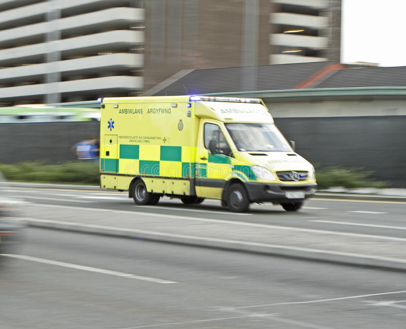 Welsh ambulance in motion. Ambulance, ambiwlans in motion on the way to a call stock photography