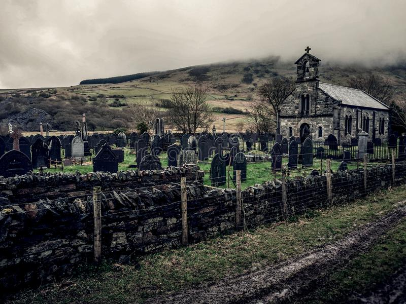 Welsh church and cemetery foggy day royalty free stock photos