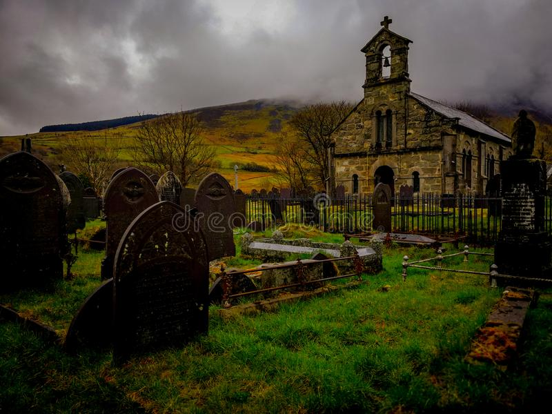 Welsh church and cemetery foggy royalty free stock photography