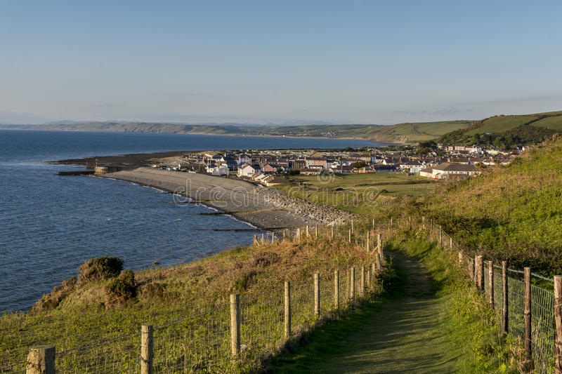 Welsh coastal path scene in Ceredigion. Aberaeron, a village in Cardigan, on the west coast of Wales, viewed from the Welsh Coastal Path stock photo