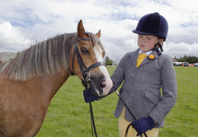 Welsh girl at dressage trial in hard hat with pony royalty free stock photo