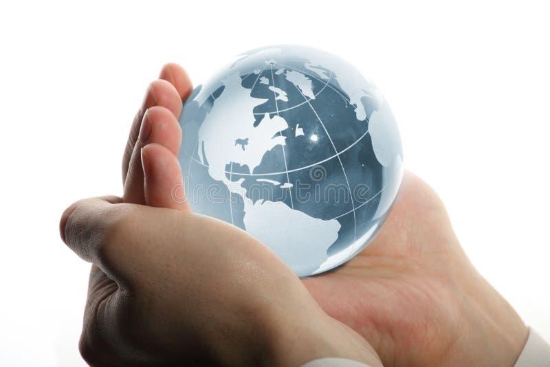 Welt in der Hand und Geschäft lizenzfreie stockfotos