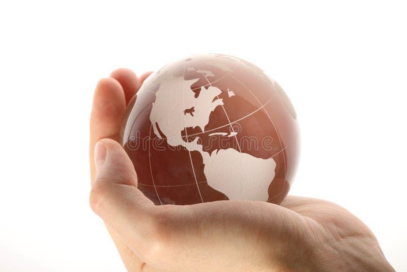Welt in der Hand und Geschäft lizenzfreie stockbilder