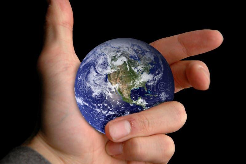 Welt zur Hand stockbilder