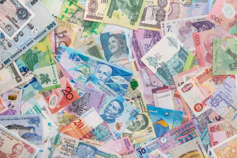 Weltgeld als Hintergrund stockfotos