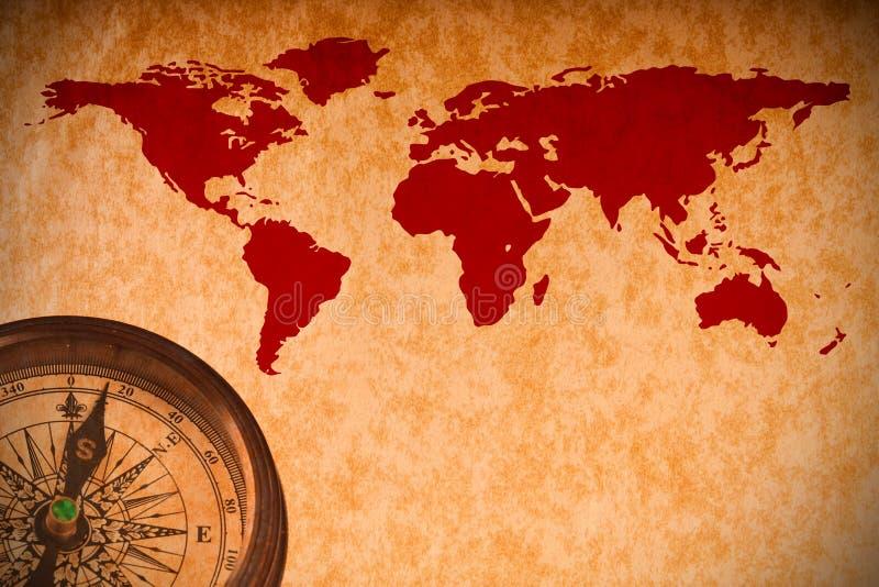 Weltkarte mit Kompaß auf Weinlesepapier lizenzfreie stockfotografie