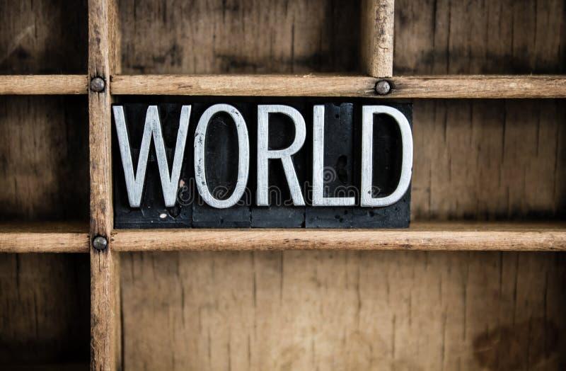 Weltkonzept-Metallbriefbeschwerer-Wort im Fach stockbild