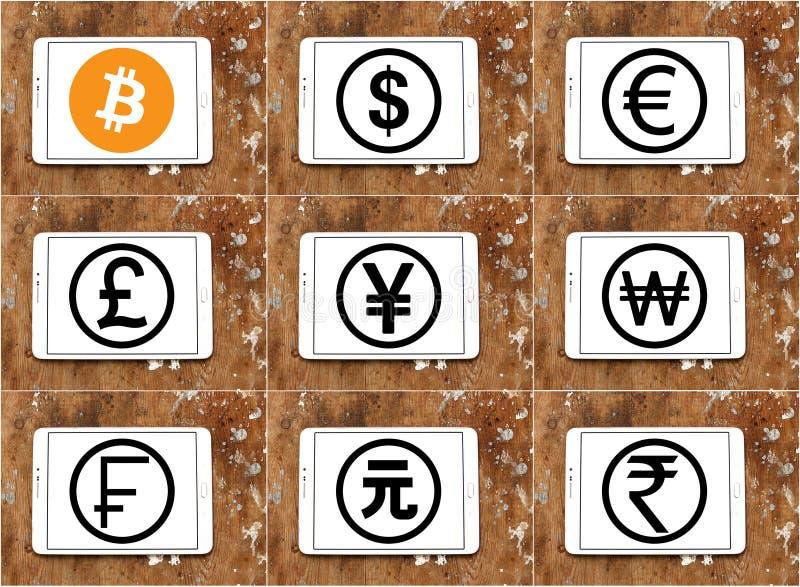 Weltwährungsikonen mit cryptocurrency bitcoin stockfoto