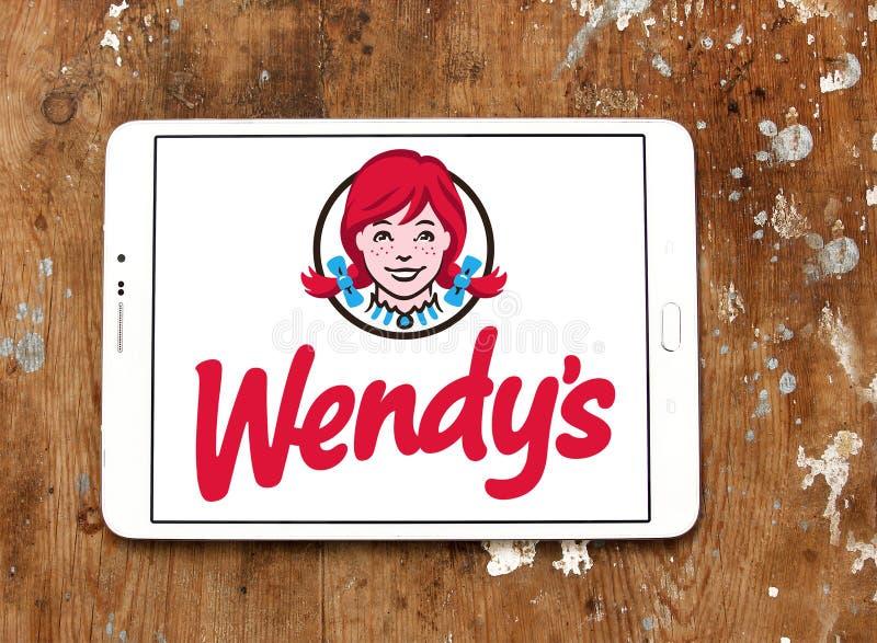 Wendys fast food logo. Logo of wendys fast food restaurants on samsung tablet on wooden background stock image