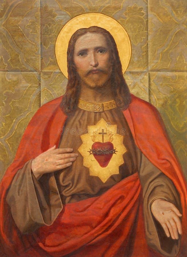 Wenen - het Hart van de verf van Jesus op het zijaltaar van Salesianerkirche door onbekende kunstenaar van 19 cent royalty-vrije stock afbeelding
