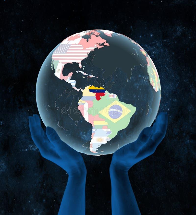 Wenezuela na politycznej kuli ziemskiej w rękach royalty ilustracja