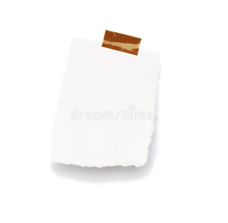 Wenig Blatt Papier hielt durch einen Kleber an stockfoto