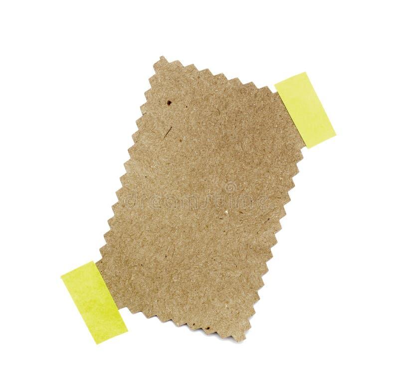 Wenig Blatt Papier hielt durch einen Kleber an stockbild