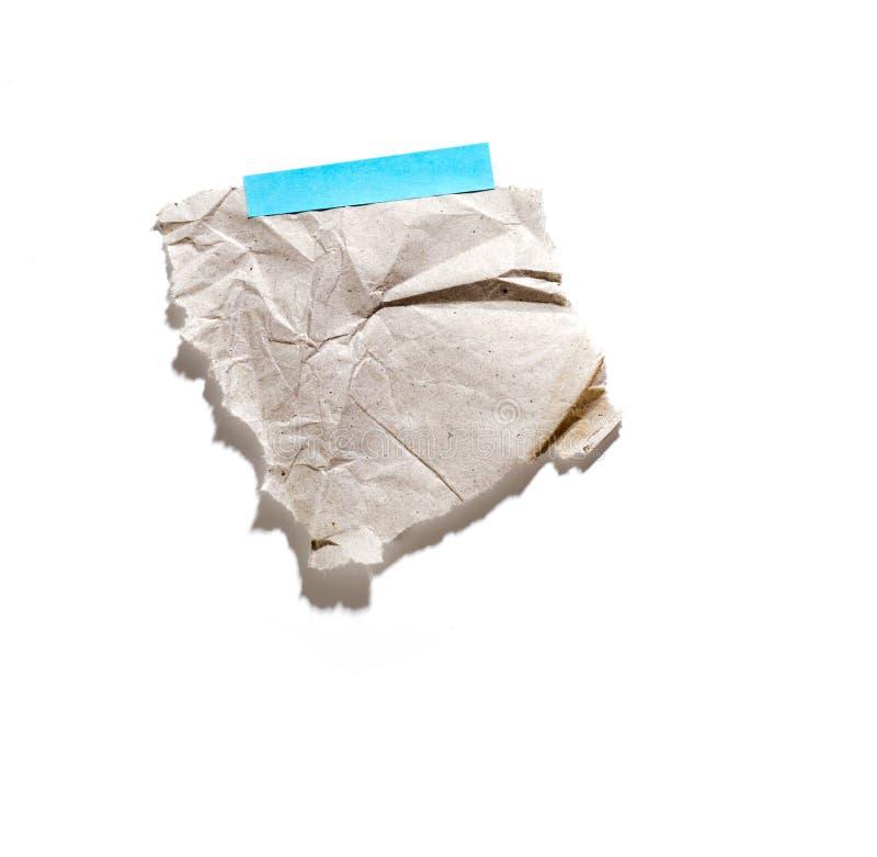 Wenig Blatt Papier hielt durch einen Kleber an stockfotografie