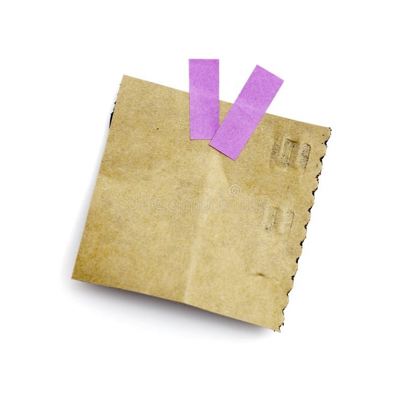 Wenig Blatt Papier hielt durch einen Kleber an stockbilder