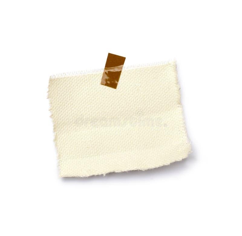 Wenig Blatt Papier hielt durch einen Kleber an stockfotos