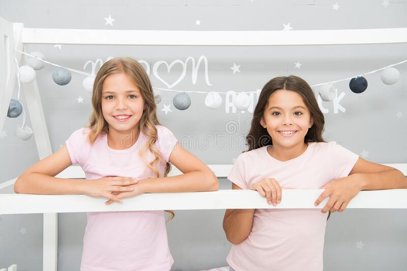 Were all unique. Happy children in nursery. Small children smile with cute look. Little children wear home clothing. Happy childhood. International childrens stock image