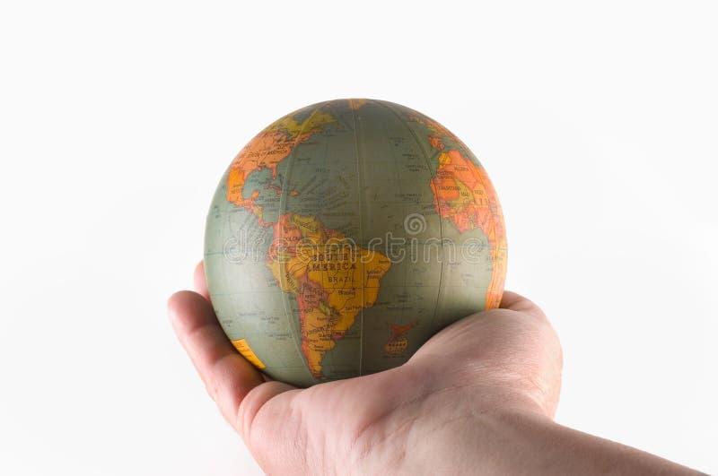 Wereld in een mannelijke hand royalty-vrije stock afbeeldingen