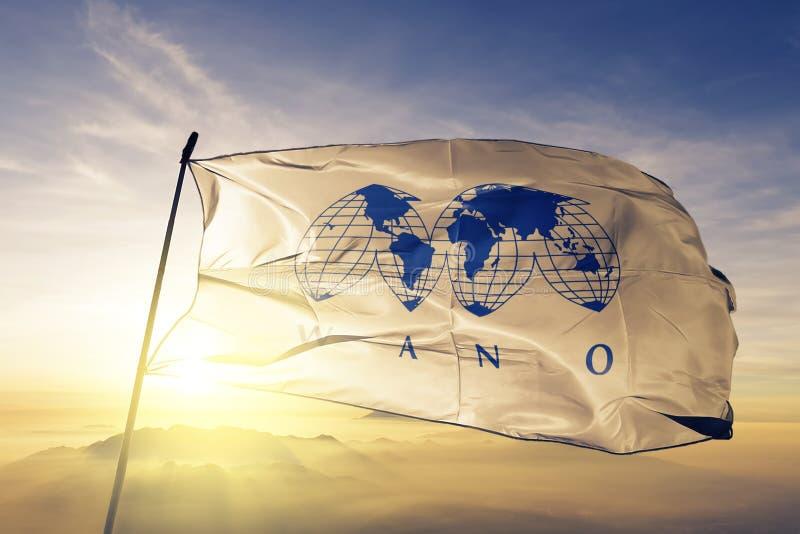 Wereldvereniging van Kern textiel de doekstof die van de Exploitantenwano vlag op de hoogste mist van de zonsopgangmist golven stock illustratie