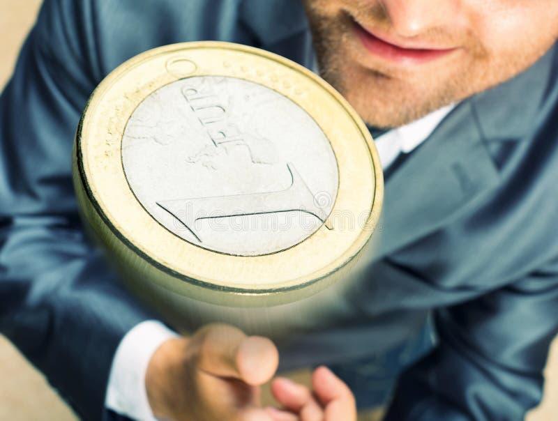 Werfen Sie eine Münze stockbild