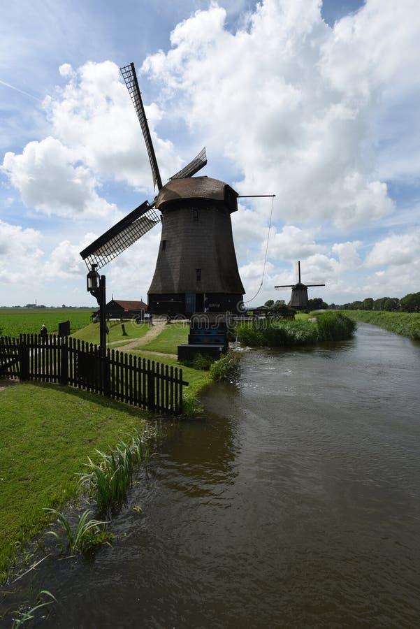 Werkende windmolens in Schermerhorn, Nederland royalty-vrije stock foto's