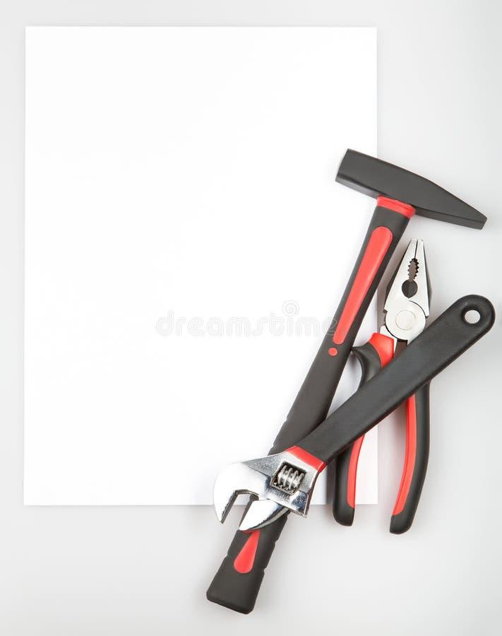 Werkzeugsatz, der einen Rahmen auf weißem Hintergrund bildet lizenzfreie abbildung