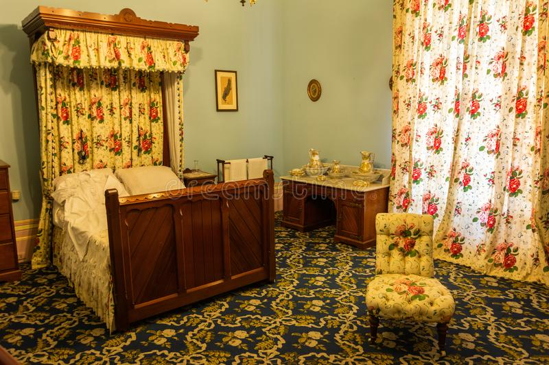Interior view of a bedroom at Werribee Park Mansion royalty free stock photography