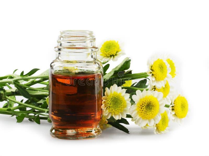 Wesentliche Schmieröle und Blumen lizenzfreie stockfotografie