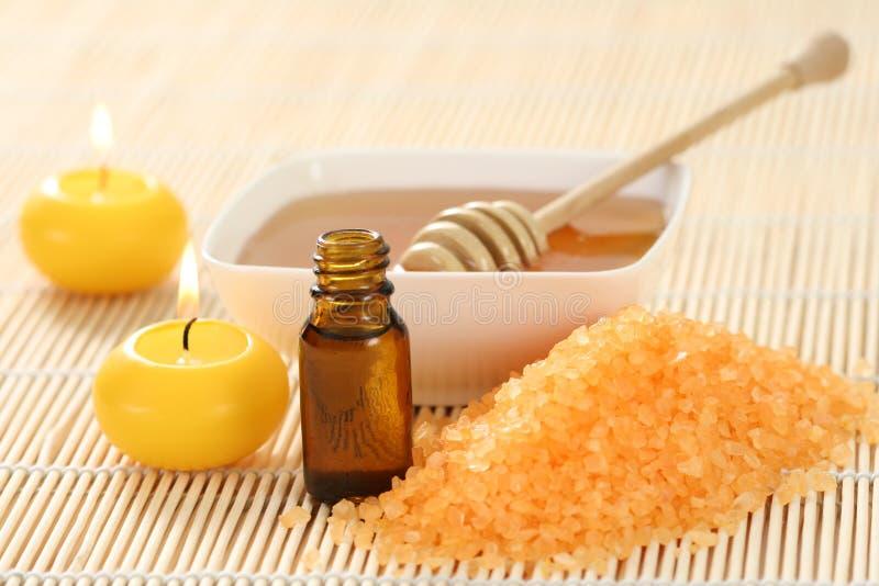 Wesentliches Schmieröl des Honigs lizenzfreie stockfotografie