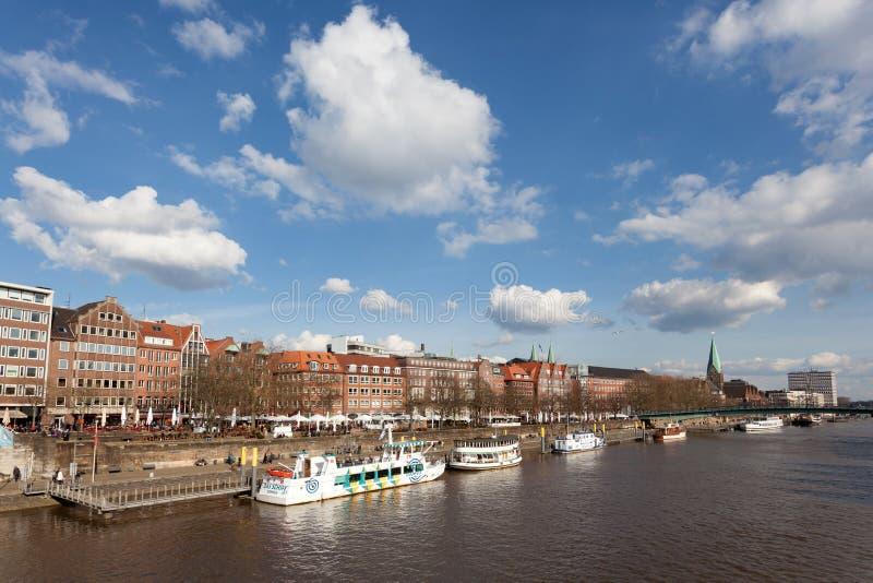 Weser river in Bremen, Germany. BREMEN, GERMANY - APR 5: Waterfront buildings at the Weser river in Bremen. April 5, 2015 in Bremen, Germany royalty free stock image